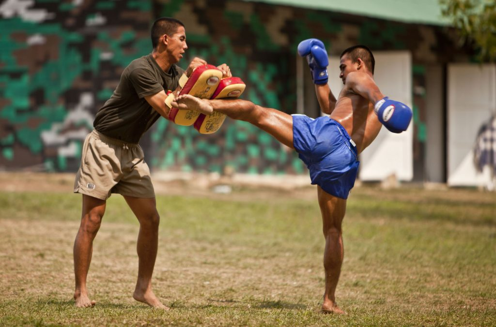 BAN CHAN KREM, Thailand -- During a cultural exchange, a Royal Thai Marine demonstrates his kicking ability which he utilizes for Thai boxing at the Ban Chan Krem training area here Feb. 15. Royal Thai Marines, Republic of Korea Marines and U.S. Marines with Combat Assault Battalion, 3rd Marine Division, III Marine Expeditionary Force, conducted trilateral training during Cobra Gold '12. Cobra Gold is a recurring multinational and multiservice exercise hosted by the Royal Kingdom of Thailand designed to advance regional security by exercising a multinational force from nations sharing common goals and security commitments in the Asia-Pacific region. (U.S. Marine Corps photo by Sgt. Brandon L. Saunders/released)